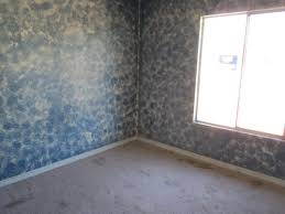 image of painting camouflage patterns on walls defendbigbird camo painted walls