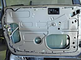 car door inside view with dust cover removed