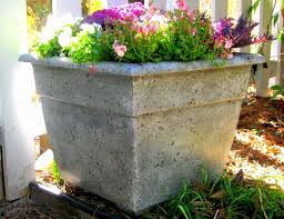 what looks like a cast concrete or stone planter is really just a plastic flower pot painted to resemble something much more hefty and y