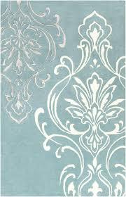 blue medallion rug area and white pottery barn bird