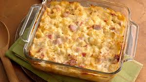baked creamy ham and potato cerole in a square baking dish
