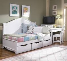 furniture white wooden wooden daybed with three storage drawers and colorful bed sheet on the