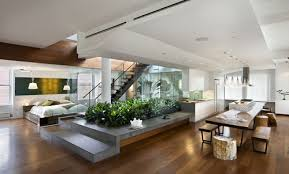 Open floor plans with loft Ceiling This Freshome Design Has The Bedroom Open To The Rest Of The Living Space And Separates It From The Kitchen With Glass Wall That Allows Sunlight To Case Design The Pros And Cons Of Open Floor Plans Case Designremodeling