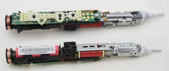 inside the sonicare toothbrush top and bottom composite view the charging coil is at