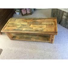 barn wood coffee table raised in a