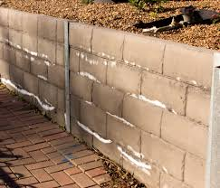 efflorescence on retaining wall