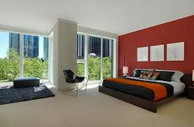 view in gallery red accent wall in the bedroom looks classy and elegant