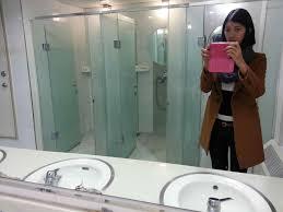 bathroom mirror reflection. Public Bathroom Mirror Reflection At Inspiring Nice Design Toilet Layout Google Interesting High School Framed With R