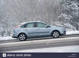 car driving side view. Beautiful View Side View Of A Car Driving Along Snow Covered Road On Winters Day In Intended Car Driving View 0