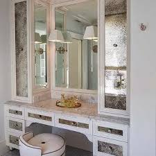antiqued mirrored cabinets