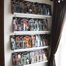 He says he has room for at least three more guys. And then, apparently, I  will need to hang him a fifth shelf. ;)