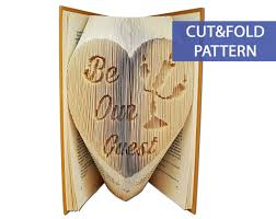 folded book art pattern cut fold be our guest