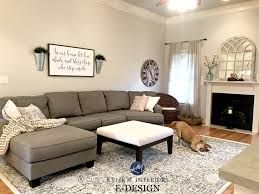 sherwin williams agreeable gray in living room with gray sectional couch area rug fireplace mirror kylie m e design and color consulting