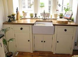 free standing kitchen cabinets white cabinets and ceramic sink and butcherblock countertop benefits of free