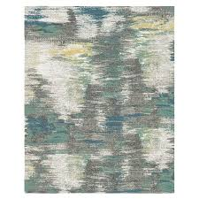 blurred landscape blue area rug