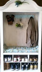 view in gallery armoire used for coat and shoe storage in a mudroom