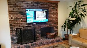how to install a flat screen tv over brick fireplace image