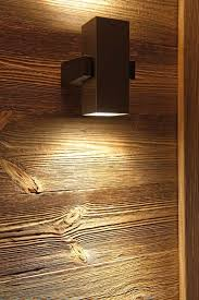 wall lamp highlighting the natural wood