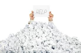 person under crumpled pile of papers a help sign isolated  person under crumpled pile of papers a help sign isolated