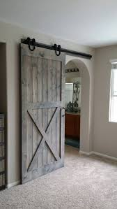 when homeowners first hear about the possibility of using barn doors as interior doors in their home the initial image that springs to mind may be