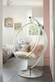 Glass bubble chair filled with a bunch of pillows  Hanging Swing ChairSwing  ChairsBedroom ...
