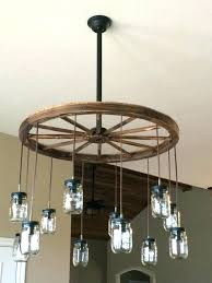 how to make a wagon wheel chandelier wagon el chandelier lodge wedding wagon and rustic theme