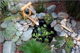 image of small bamboo outdoor water fountains