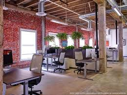 beautiful office spaces. designer loft with beautiful walnut tops on our height adjustable bases love this look office interiorsoffice spaces