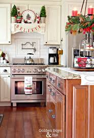 Christmas decor in kitchen with DIY mantel hood and candle chandelier over  island-www.