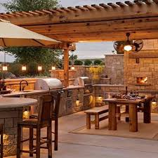 outdoor kitchen lighting. Outdoor Kitchen With Fireplace And Dining Table Lighting G