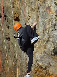 Image result for picture of a woman climbing a mountain