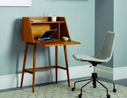 The secretary desk. Distinguished by a vertical hutch that drops down to  act as a flat surface, the secretary desk hit its stride during the '50s  and '60s, ...