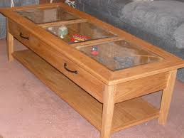 glass display case coffee table drawers