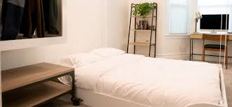 a blebee spaces bedroom with the closet and bed lowered