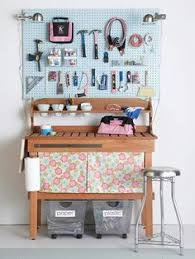 a traditional potting bench makes a great work bench with a large surface area for working pegboard keeps tools within reach though i m no fan of pink