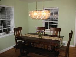 dark wood dining table with dark wood floor and interesting capiz chandelier plus bali blinds