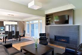 white tile fireplace family room modern with tv over top standard height dining tables