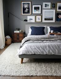 image of rug under bed rug placement area rug under bed ideas for dark floors