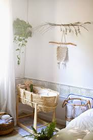 Sweet natural nursery corner with seagrass bassinet crib