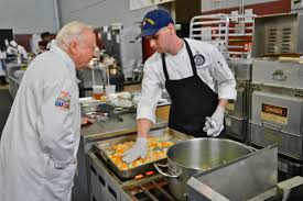 homeland security petty officer 2nd class ben stockman chats a judge during 42nd annual military culinary arts