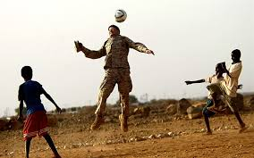 u s department of > photos > photo essays > essay view a u s marine plays soccer children in negad 22 2008