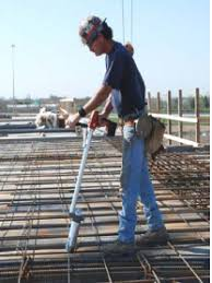 worker using rebar tying tool with coiled spring wire handle rebar worker