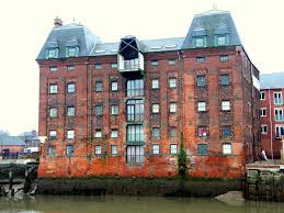 A Victorian riverside warehouse has been converted into apartments. I'm not  sure I would like to live here considering that it is next door to the  North ...