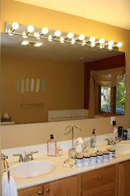 above mirror bathroom lighting. 7 photos of the track lighting over bathroom oval mirror above