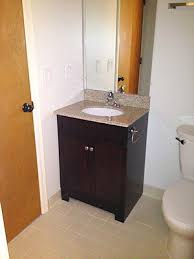installing bathroom vanity. finished vanity installation. bathroom installing