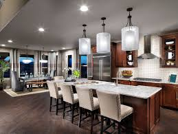 there are many beautiful fixtures to choose from when selecting lighting for your kitchen island