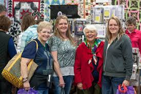 Shop. Learn. Experience. – March 1-4, 2018 | Puyallup, WA & four happy Sew Expo attendees Adamdwight.com