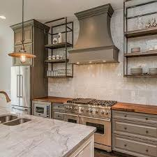 gray kitchen cabinets with butcher block top