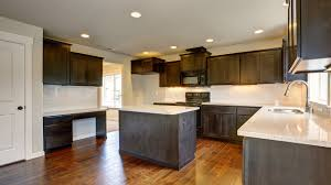 Should You Stain Or Paint Your Kitchen Cabinets For A Change In