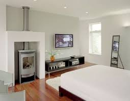 View in gallery Compact gas woodstove in the bedroom